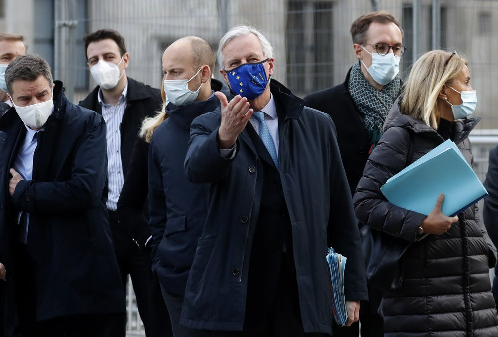 """FILE - In this file photo dated Thursday, Nov. 12, 2020, European Commission's Head of Task Force for Relations with the United Kingdom Michel Barnier, centre, leaves the Conference Centre in London with unidentified members of his team. The Brexit trade negotiations have been suspended Thursday Nov. 19, 2020, at a crucial stage because an EU negotiator has tested positive for the coronavirus and EU chief negotiator Michel Barnier said that """"we have decided to suspend the negotiations at our level for a short period."""" ."""