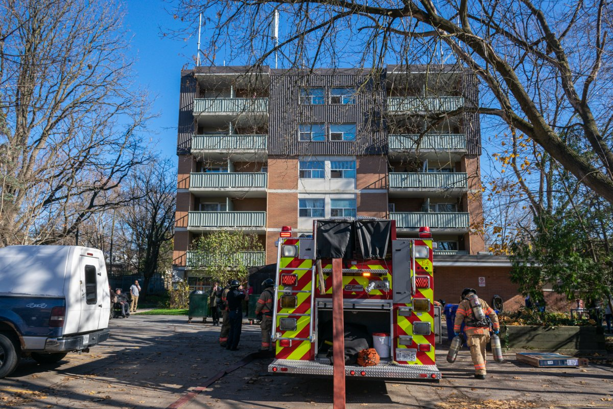 London Fire Department members at the scene of a fire on the third floor of 872 William St. in London, Ont., Nov. 12, 2020.