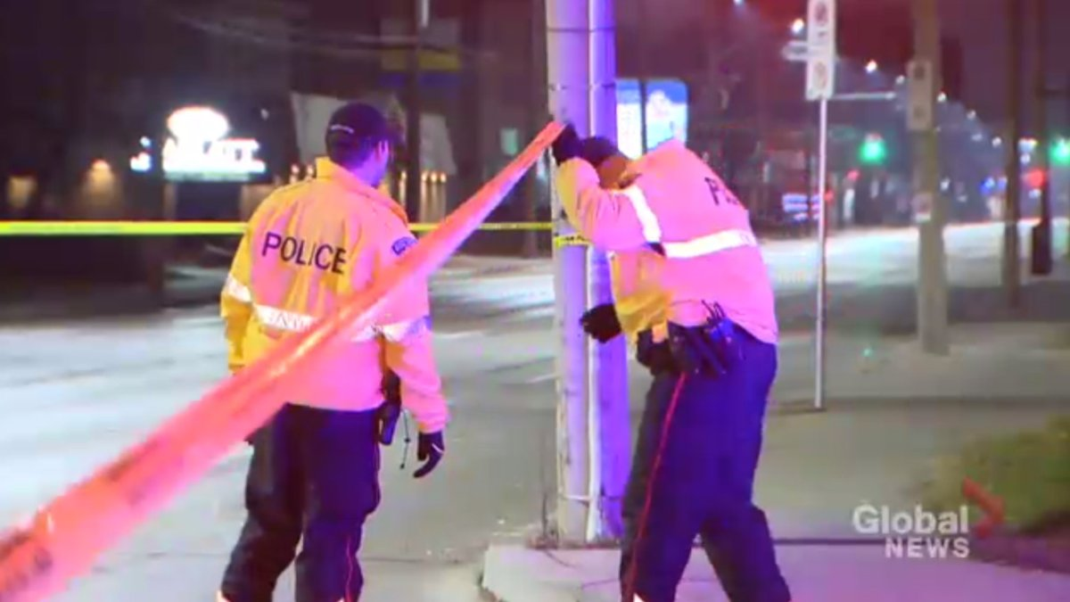 Two Hamilton police officers on scene near Main and Sanford Streets after 19-year-old Yosif Al-Hasnawi was shot on Dec. 2, 2017.