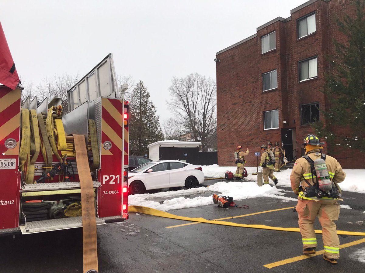 Crews put out a fire on the second storey of an apartment building on Baseline Road on Thursday, Nov. 26, 2020.