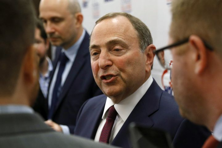 FILE - In this Dec. 12, 2019, file photo, NHL Commissioner Gary Bettman speaks with members of the media before being inducted into the U.S. Hockey Hall of Fame in Washington.