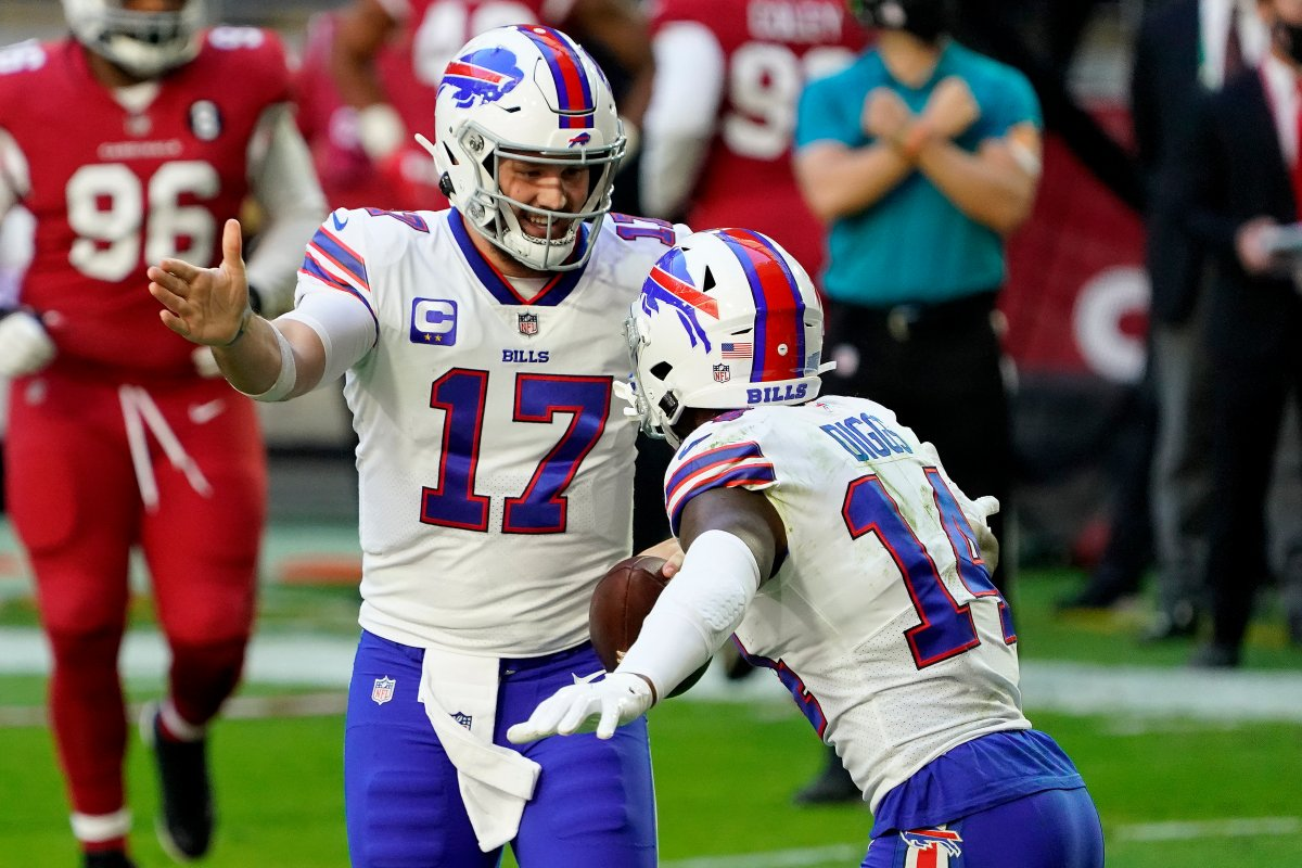 Buffalo Bills quarterback Josh Allen (17) celebrates his touchdown with wide receiver Stefon Diggs (14) during the first half of an NFL football game against the Arizona Cardinals, Sunday, Nov. 15, 2020, in Glendale, Ariz.