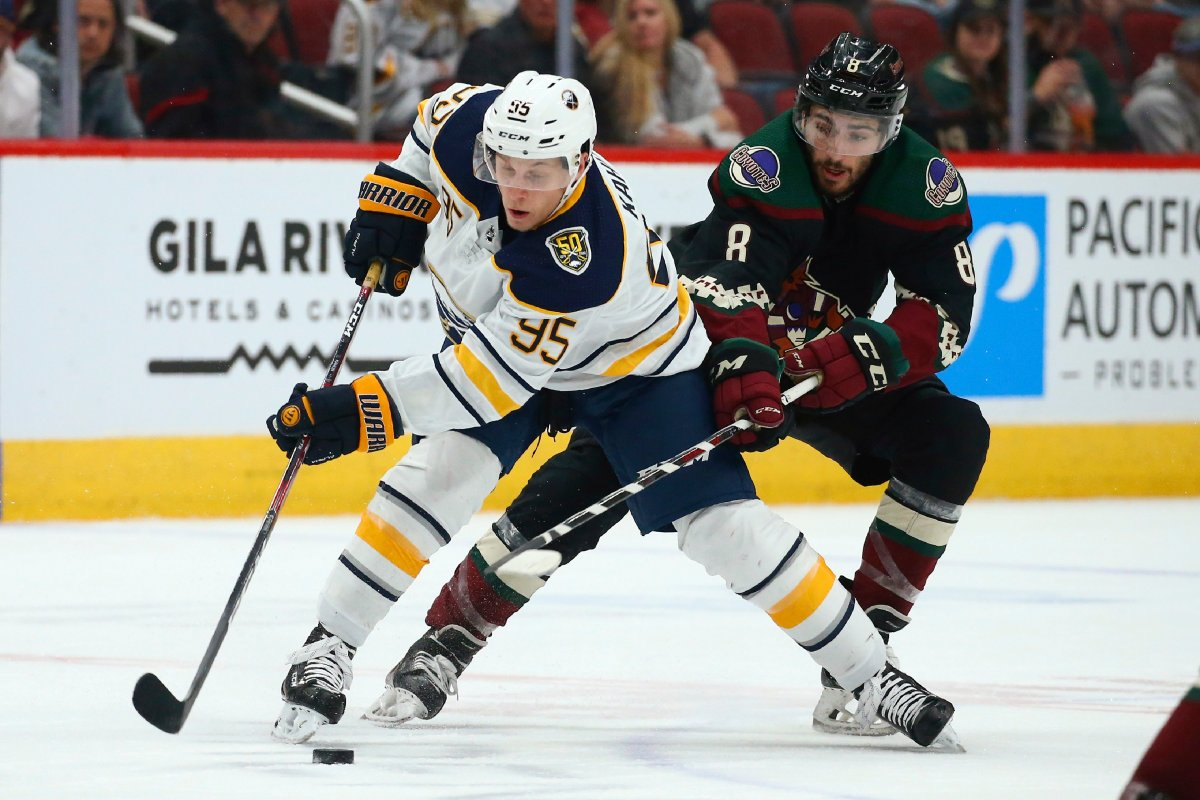 FILE - In this Feb. 29, 2020, file photo, Buffalo Sabres center Dominik Kahun (95) tries to keep the puck away from Arizona Coyotes center Nick Schmaltz (8) during an NHL hockey game in Glendale, Ariz.  (AP Photo/Ross D. Franklin, File).