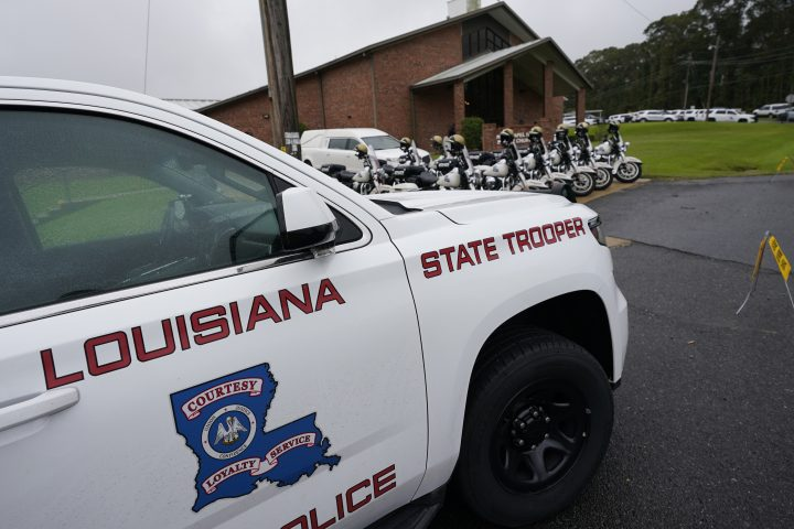 FILE - In this Sept. 25, 2020 file photo, a heavy Louisiana State Police presence is seen at the New Chapel Hill Baptist Church during funeral services for Master Trooper Chris Hollingsworth in West Monroe, La.