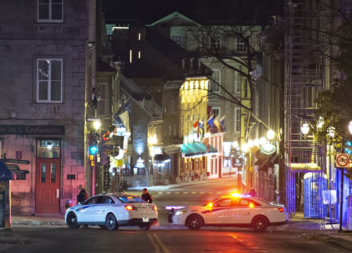 Police cars block the Saint-Louis Street near the Chateau Frontenac, early Sunday, November 1, 2020 in Quebec City. A man wearing medieval clothed was arrested. Two people are dead and five people were injured after they were stabbed.