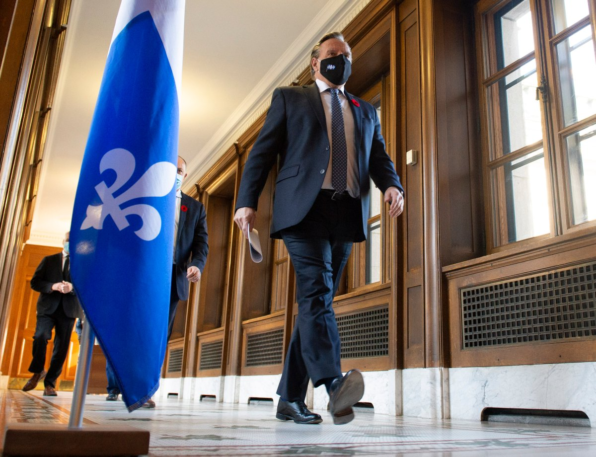 Quebec Premier Francois Legault walks to a news conference on the COVID-19 pandemic, Thursday, November 5, 2020 at the legislature in Quebec City.