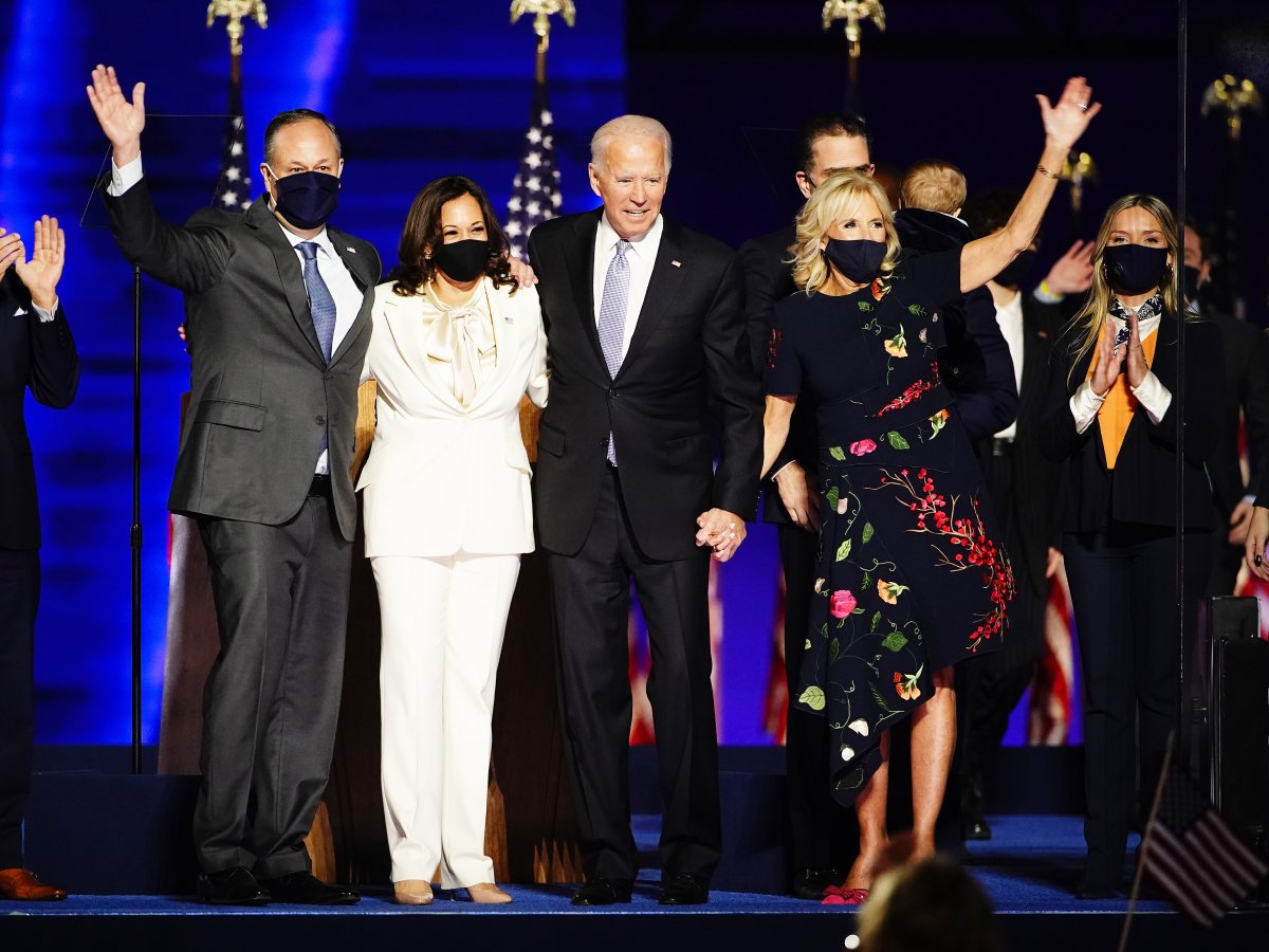President-elect Joe Biden (2R) and Dr. Jill Biden (R) with Vice President Elect Kamala Harris (2L) and Doug Emhoff (L) are joined by family members wave after Biden delivered his victory address after being declared the winner in the 2020 presidential election in Wilmington, Delaware, USA, 07 November 2020. Biden defeated incumbent US President Donald J. Trump. EPA/JIM LO SCALZO.
