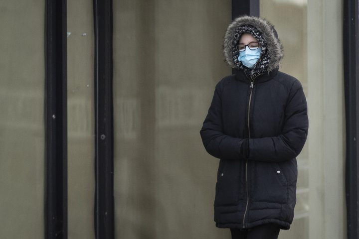 A person wears a mask in Kingston, Ontario on Monday, November 23, 2020, as the COVID-19 pandemic continues across Canada and around the world.