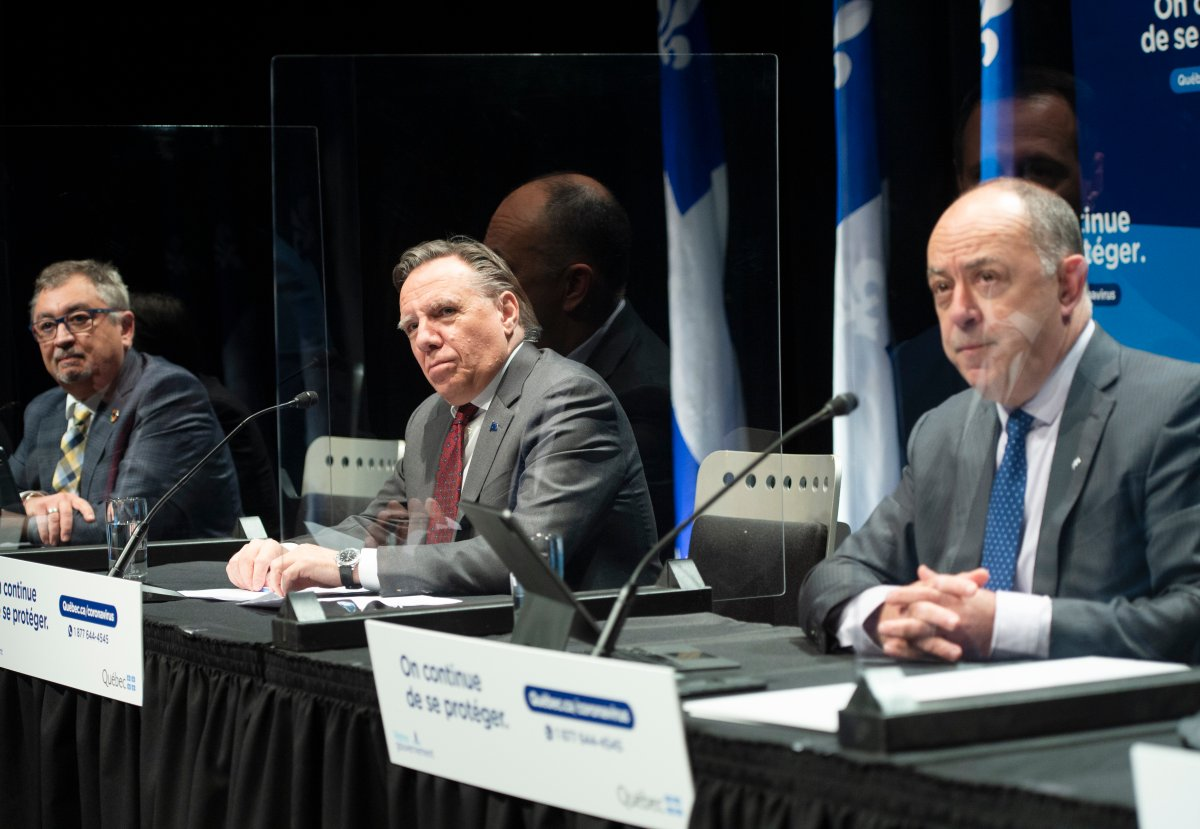 Quebec Public Health Director Horacio Arruda, left to right, Quebec Premier Francois Legault and Health Minister Christian Dube speak to the media at the COVID-19 press briefing in Montreal, Thursday, Nov. 19, 2020. THE CANADIAN PRESS/Ryan Remiorz.