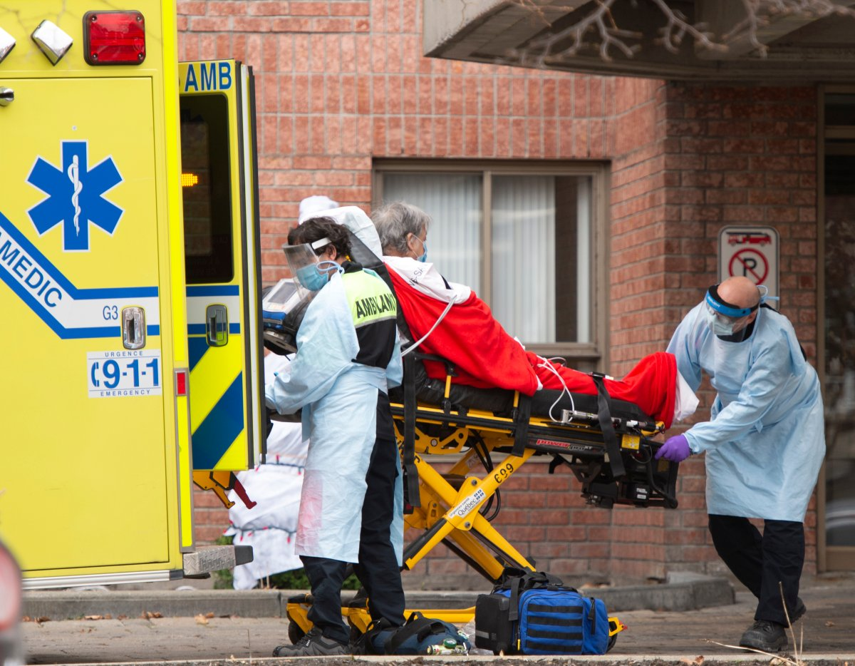 First responders transport a resident from a long term care facility Friday, November 20, 2020  in Montreal.