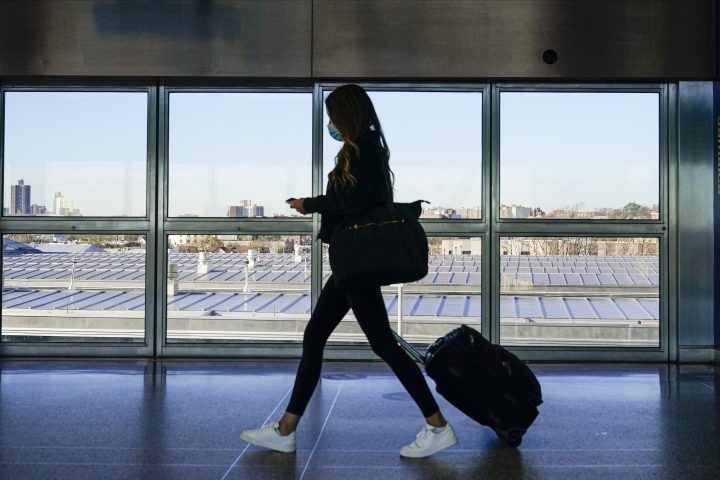 A traveler approaches the AirTrain to JKF International Airport Friday, Nov. 20, 2020, in New York.