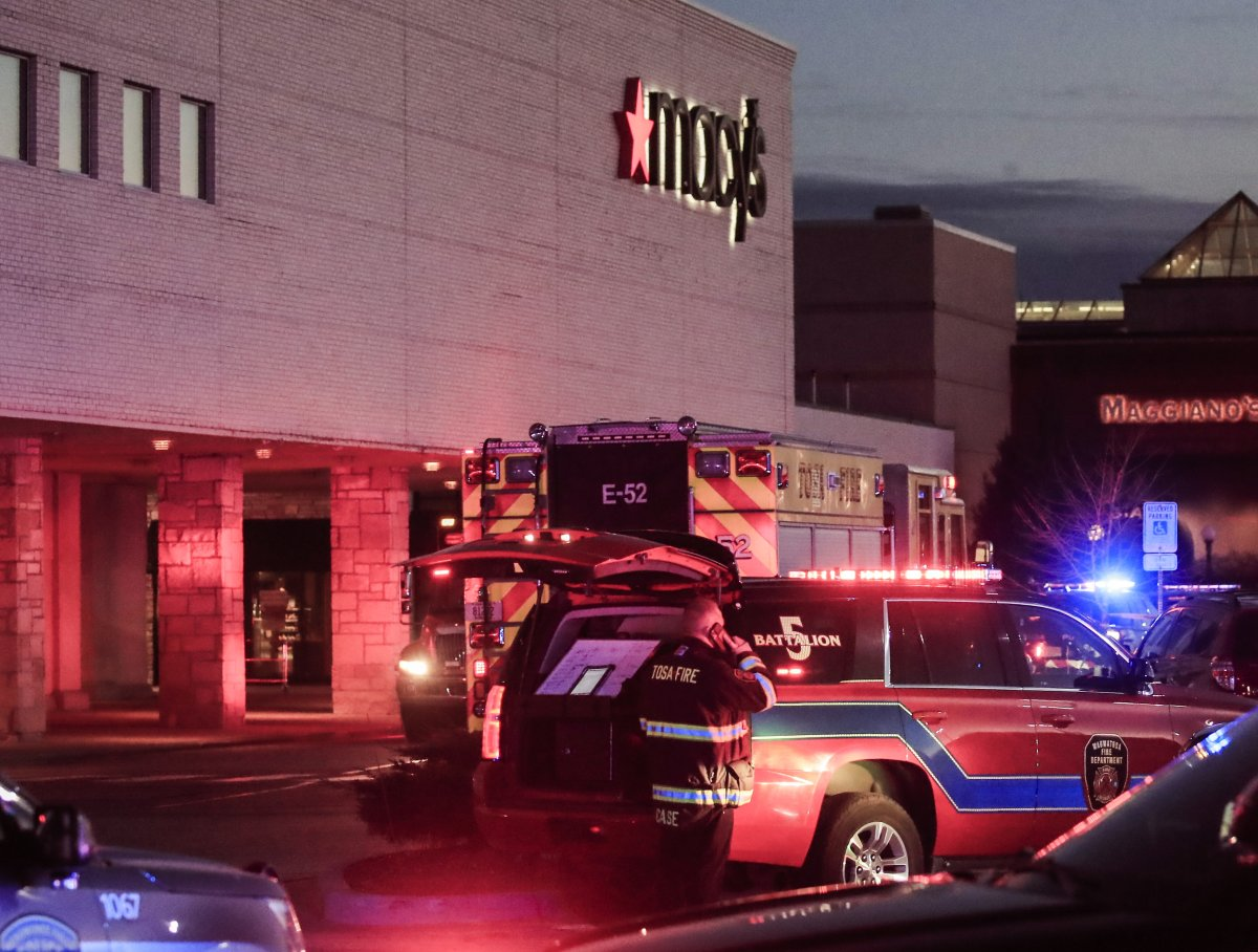 Emergency personnel stand outside after reports of multiple people shot at the Macy's department store in the MayFair Mall in Wauwatosa, Wisconsin, Nov. 20, 2020.