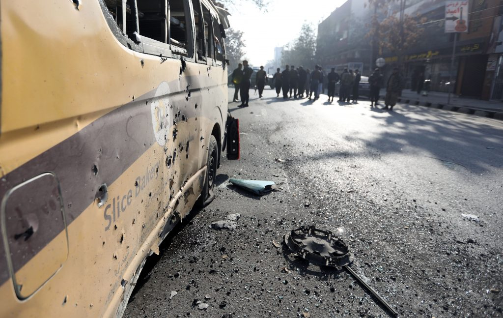Afghan security forces cordon off the area of a rocket attack site in Kabul, Afghanistan, 21 November 2020. According to media reports at least one person was killed and three others were injured as several rockets landed on the Afghann capital.  EPA/Jawad Jalali.