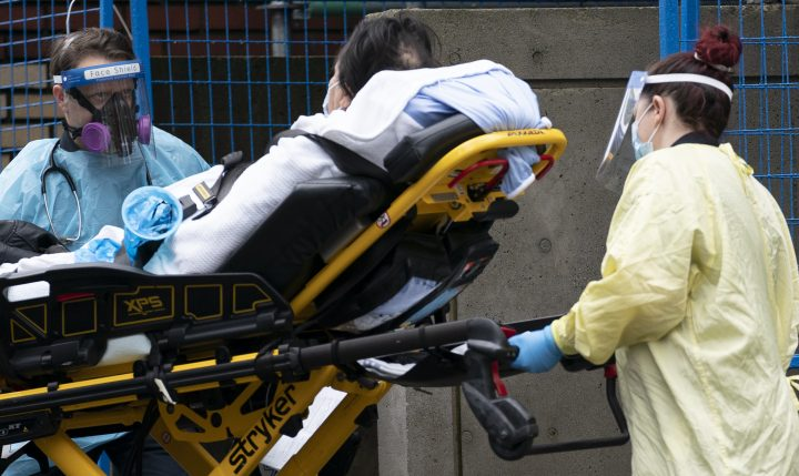 Medical personnel wear personal protective equipment to help prevent the spread of COVID-19 as they wheel a patient into St. Paul's hospital in downtown Vancouver Monday, November 23, 2020. THE CANADIAN PRESS/Jonathan Hayward.