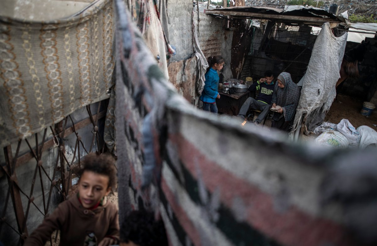 A Palestinian family prepares tea in their house in a slum on the outskirts of Khan Younis Refugee Camp, in the southern Gaza Strip,  Nov. 25, 2020.