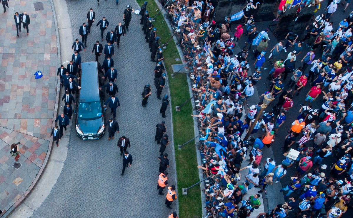 The hearse carrying the casket of Diego Maradona leaves the government house in Buenos Aires, Argentina, Thursday, Nov. 26, 2020.