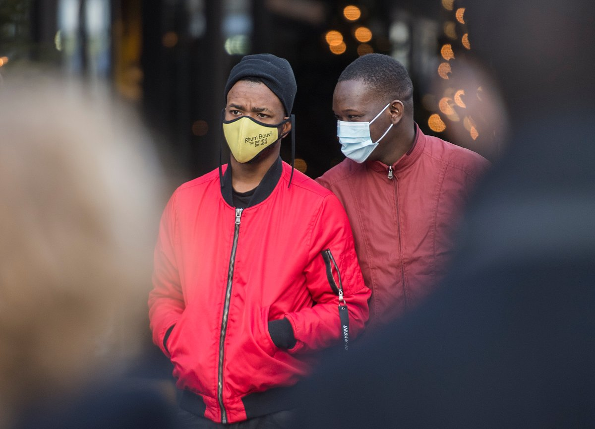 People wear face masks as they walk along a street in Montreal, Sunday, Nov. 29, 2020, as the COVID-19 pandemic continues in Canada and around the world.