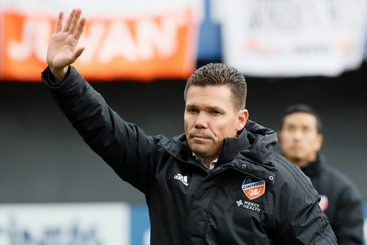 FC Cincinnati head coach Alan Koch waves to the crowd before an MLS soccer match against the Portland Timbers, Sunday, March 17, 2019, in Cincinnati. (AP Photo/John Minchillo).