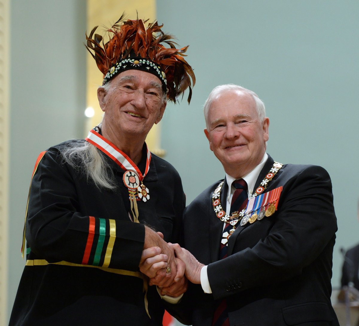 Magella (Max) Gros-Louis of Wendake, Que., gets invested as an Officer of the Order of Canada by Governor General David Johnston during a ceremony at Rideau Hall in Ottawa on Friday, Feb. 12, 2016.
