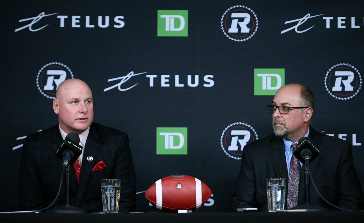 Ottawa Redblacks head coach Paul LaPolice and general manager Marcel Desjardins participate in a press conference in Ottawa, on Monday, Dec. 9, 2019. Both will be returning in 2021, the club announced Wednesday.