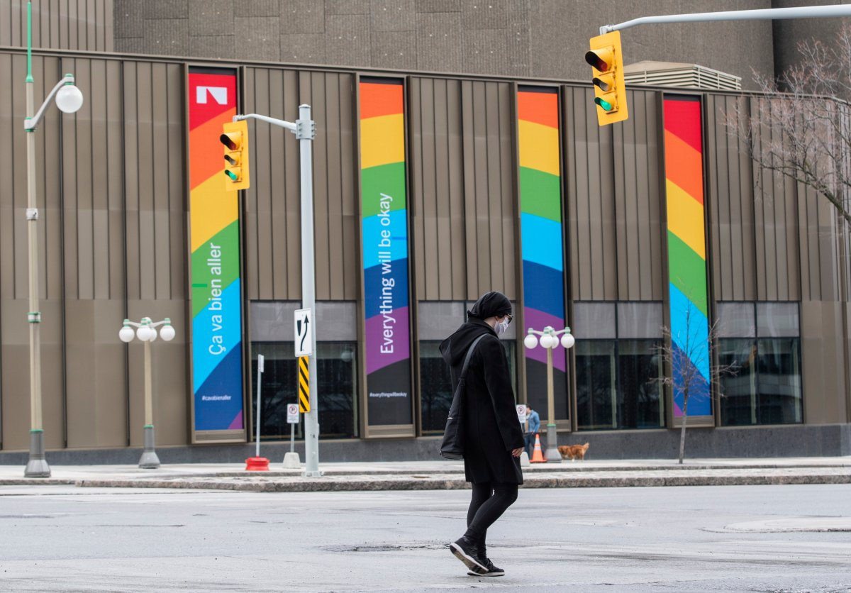 """Digital screens on the side of the National Arts Centre display the message """"Everything will be okay"""" and a rainbow, in the midst of the COVID-19 pandemic on Sunday, April 19, 2020."""