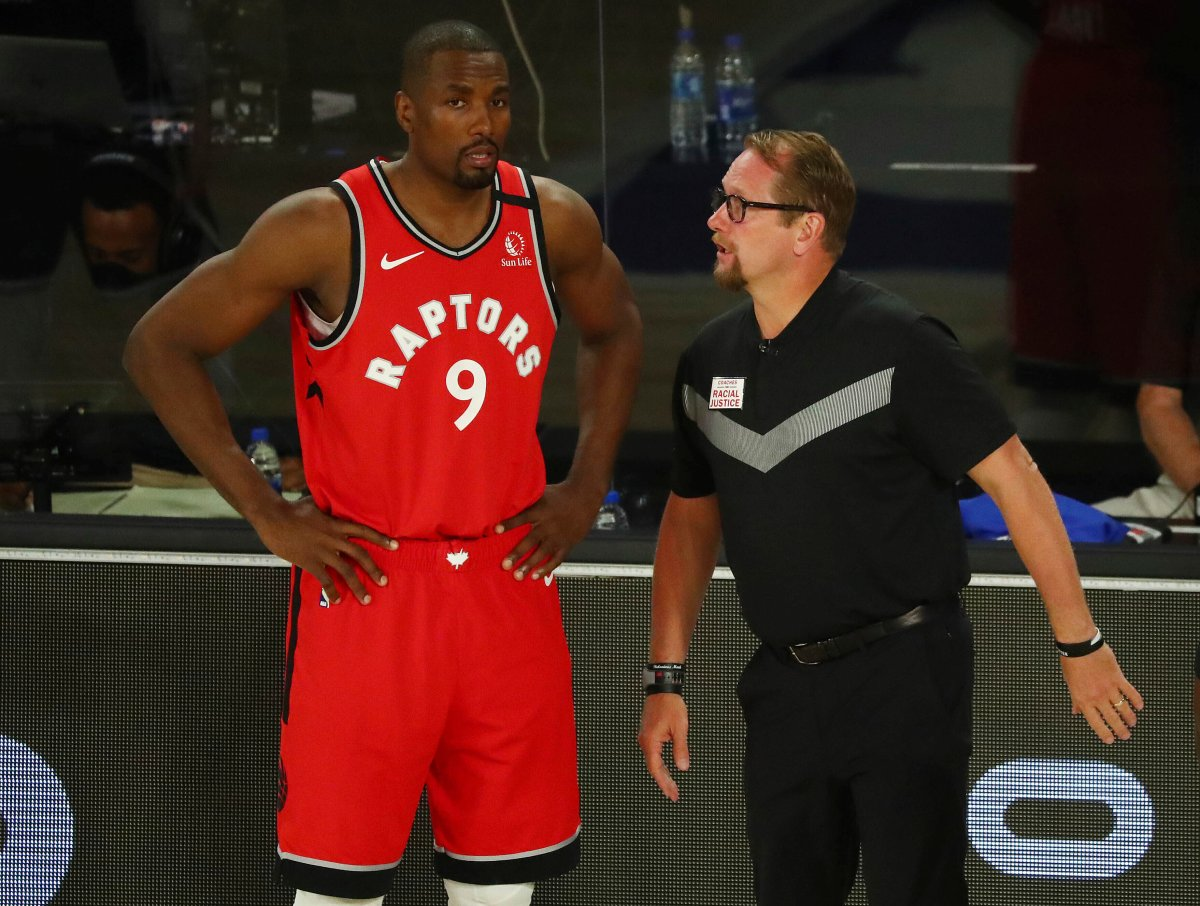 Toronto Raptors centre Serge Ibaka (9) speaks with head coach Nick Nurse during a game against the Brooklyn Nets during the first half of Game 4 of an NBA basketball first-round playoff series, Sunday, Aug. 23, 2020, in Lake Buena Vista, Fla.