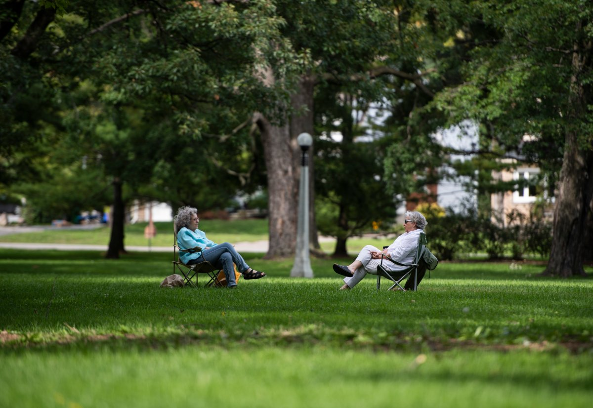 People sit in lawn chairs as they talk at Commissioners Park in Ottawa on the Labour Day long weekend, Sunday, Sept. 6, 2020, in the midst of the COVID-19 pandemic. A new report on search trends in Ottawa reveals a spike in searches for local parks and outdoor activities from March to October, 2020.