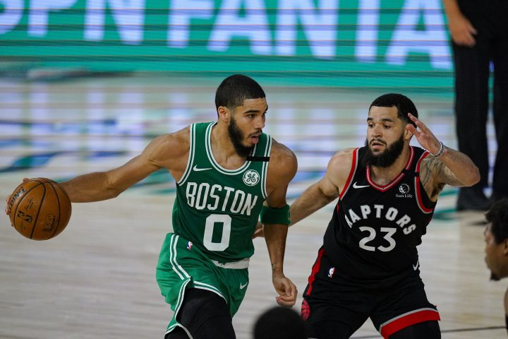 Boston Celtics forward Jayson Tatum (0) drives on Toronto Raptors guard Fred VanVleet (23) during the second half of an NBA conference semifinal playoff basketball game Wednesday, Sept. 9, 2020, in Lake Buena Vista, Fla.