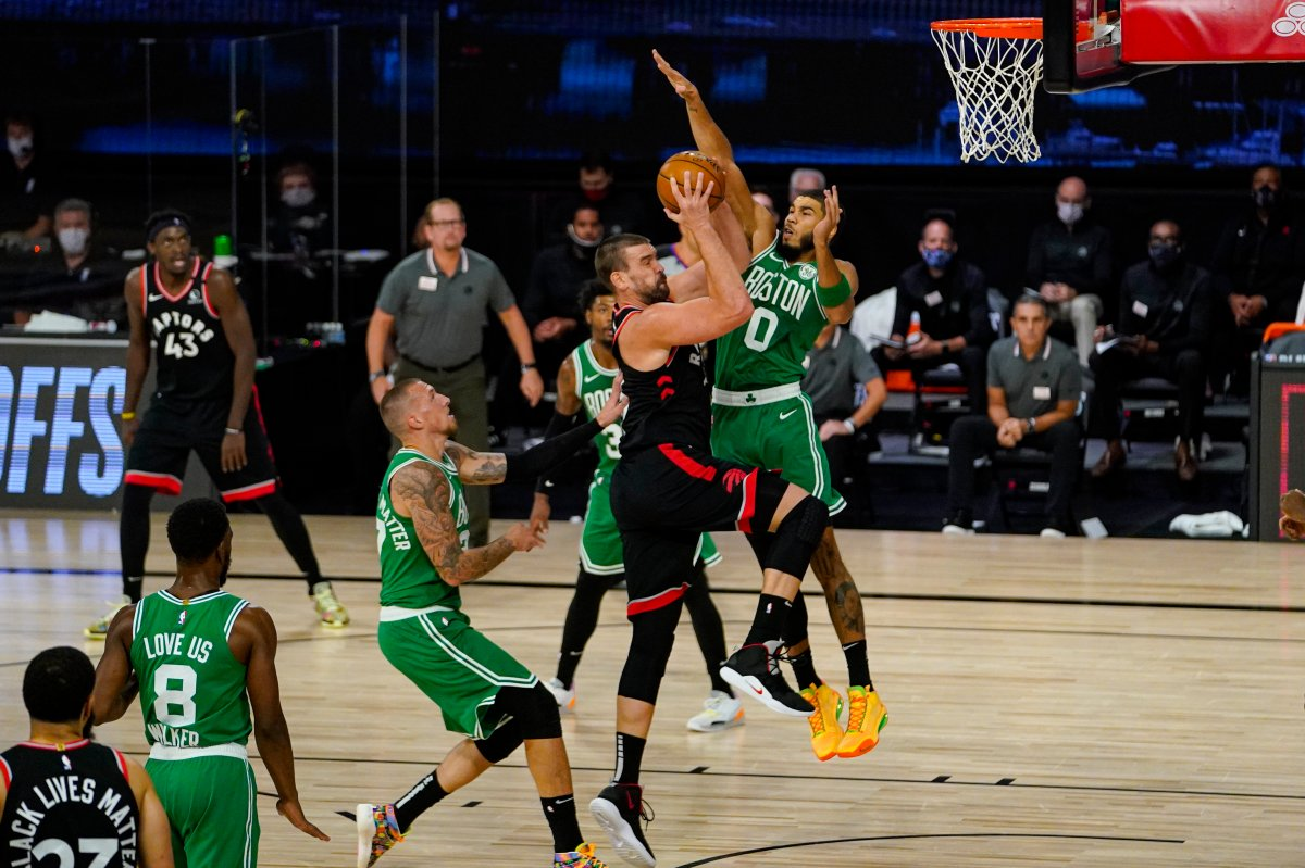 Toronto Raptors center Marc Gasol (33) shoots over Boston Celtics forward Jayson Tatum (0) during the first half of an NBA conference semifinal playoff basketball game Wednesday, Sept. 9, 2020, in Lake Buena Vista, Fla.