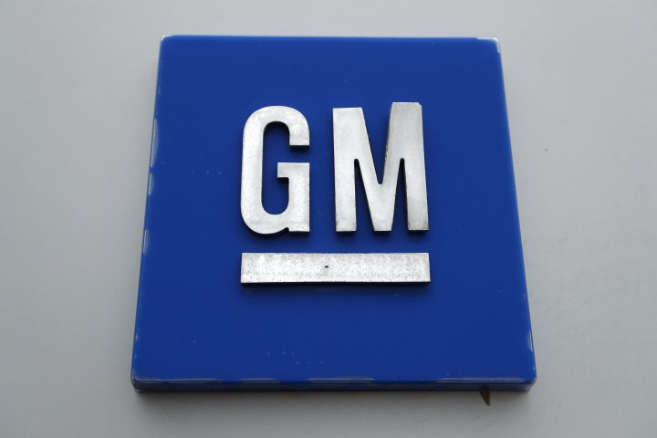 FILE - This Jan. 27, 2020, file photo shows a General Motors logo at the General Motors Detroit-Hamtramck Assembly plant in Hamtramck, Mich.