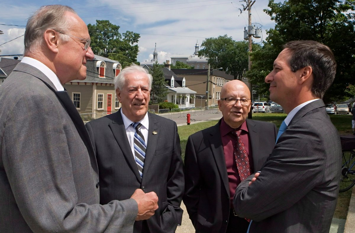 From left, former PQ ministers Jean Rochon, Marc-Andre Bedard and Guy Chevrette discuss with PQ leader Stephane Bedard, before the funeral of Jean Garon, Saturday July 12, 2014, in Levis. Marc-Andre Bedard has died.