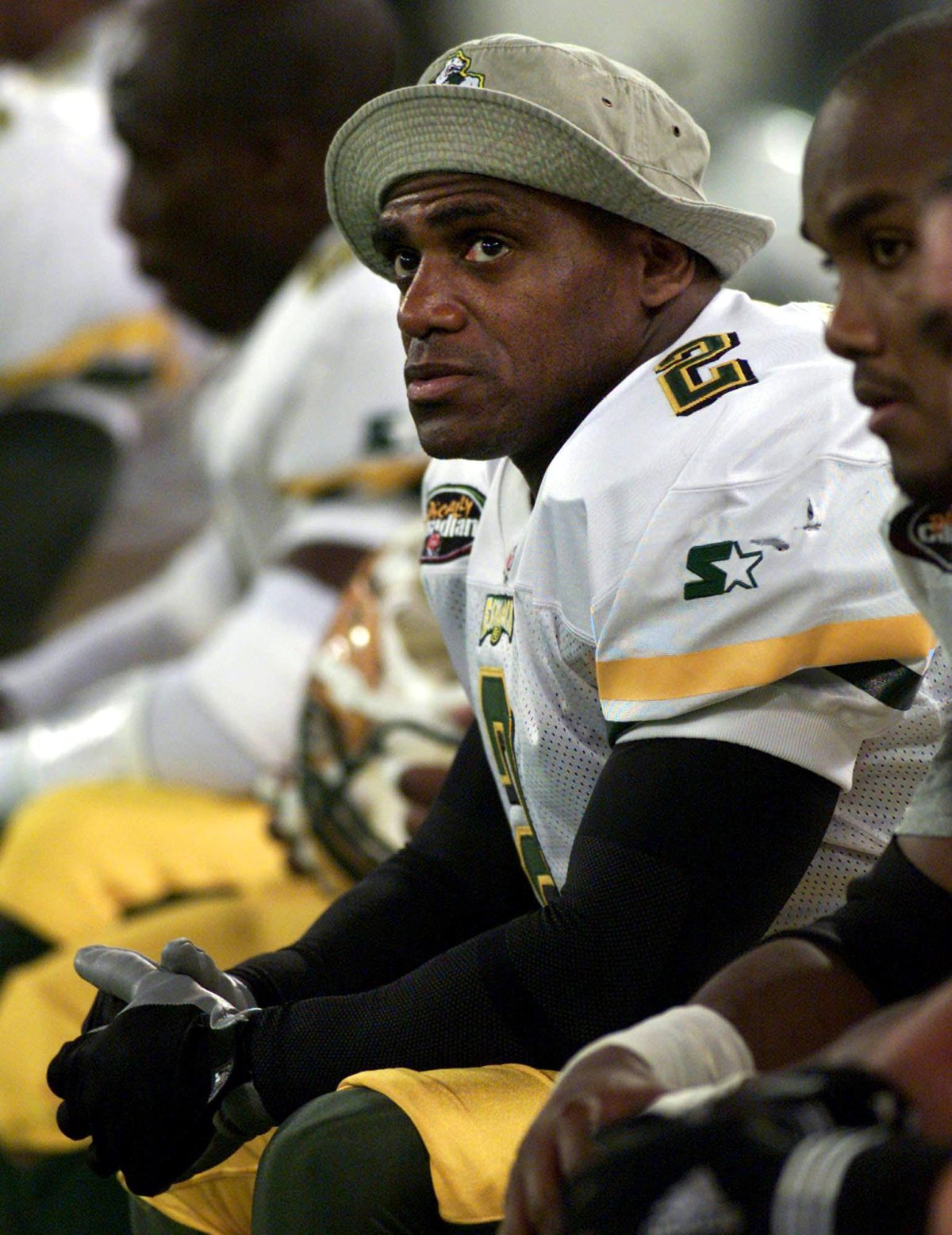 Edmonton Eskimos' Henry (Gizmo) Williams sits on the bench during the final minutes of the fourth quarter of CFL action against the Toronto Argonauts in Toronto Saturday Nov.  6, 1999.  (CP PHOTO/Kevin Frayer).