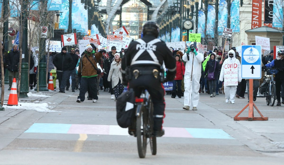 Hundreds of people gather in downtown Calgary to protest mandatory COVID-19 restrictions, Saturday, Nov. 28, 2020.