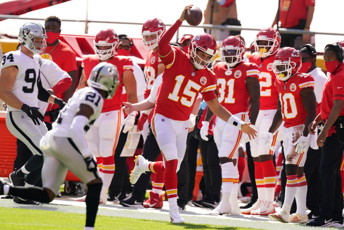 Kansas City Chiefs quarterback Patrick Mahomes (15) runs from Las Vegas Raiders cornerback Amik Robertson (21) during the first half of an NFL football game, Sunday, Oct. 11, 2020, in Kansas City.