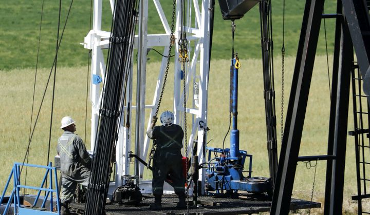 An energy drilling rig works on an oilfield well, belonging to Ridgeback Resources, near Cochrane, Alberta on Sept. 9, 2020.