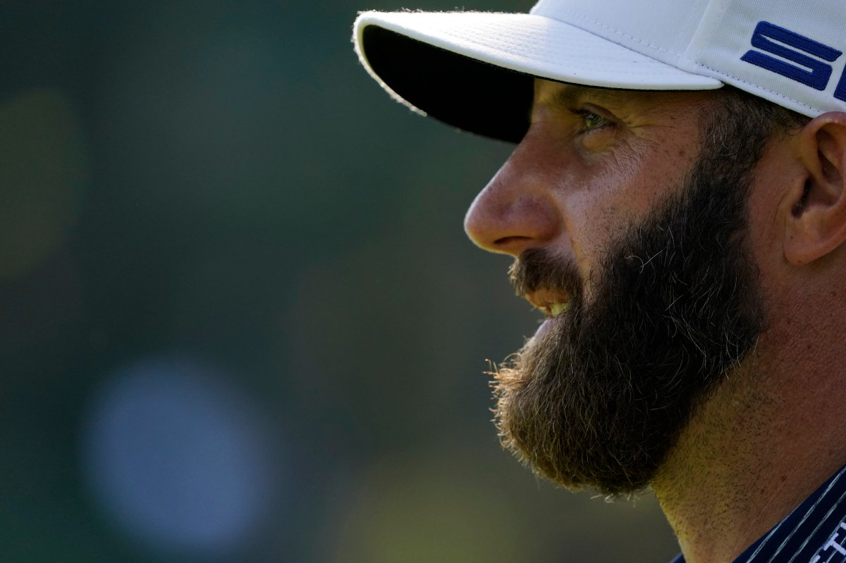Dustin Johnson watches his tee shot on the 17th hole during the final round of the Masters golf tournament Sunday, Nov. 15, 2020, in Augusta, Ga.