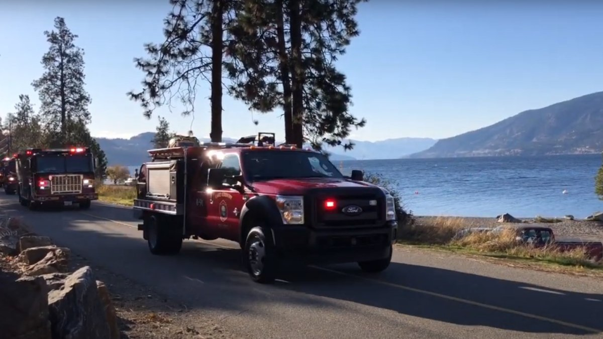 Fire vehicles from as far away as Salmon Arm and Peachland joined in a memorial procession for Lake Country firefighter Karl Featerstone on the weekend.