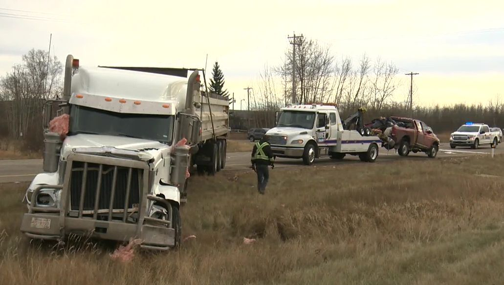 A crash between a red pickup and a semi dump truck happened north of Devon on Highway 60 around 12:30 p.m. Wednesday, Nov. 4, 2020.