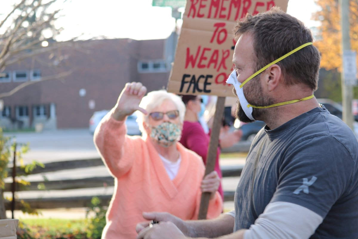 Aylmer Ont. residents opposed to the demonstration lined the streets with some heated moments between residents who did not want the anti-mask rally in their town. Nov. 7, 2020.