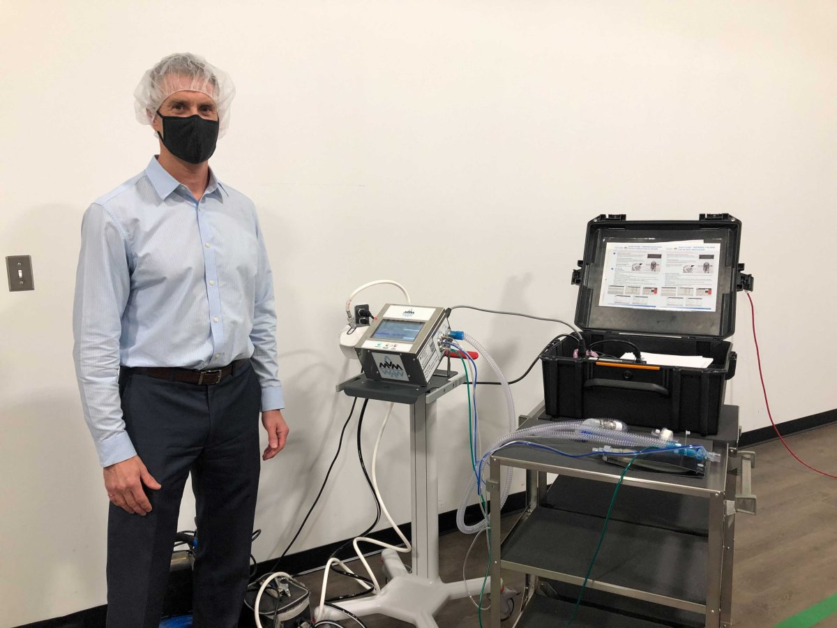 JMP Solutions president and CEO Scott Shawyer stands next to a Mechanical Ventilator Milano (MVM) ventilator that was assembled in London, Ont.