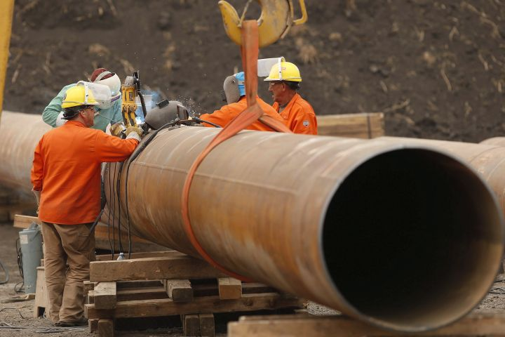 Enbridge workers weld pipe just west of Morden, Man., Thursday, Aug. 16, 2018. A press conference and tour of a Line 3 site for federal, provincial, municipal and indigenous leaders was held at the site.