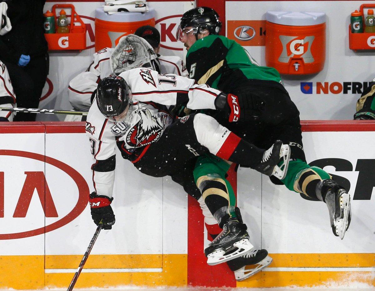 Prince Albert Raiders' Zack Hayers (5) and Rouyn-Noranda Huskies' Jakoub Lauko collide during Memorial Cup hockey action in Halifax, Monday, May 20, 2019.