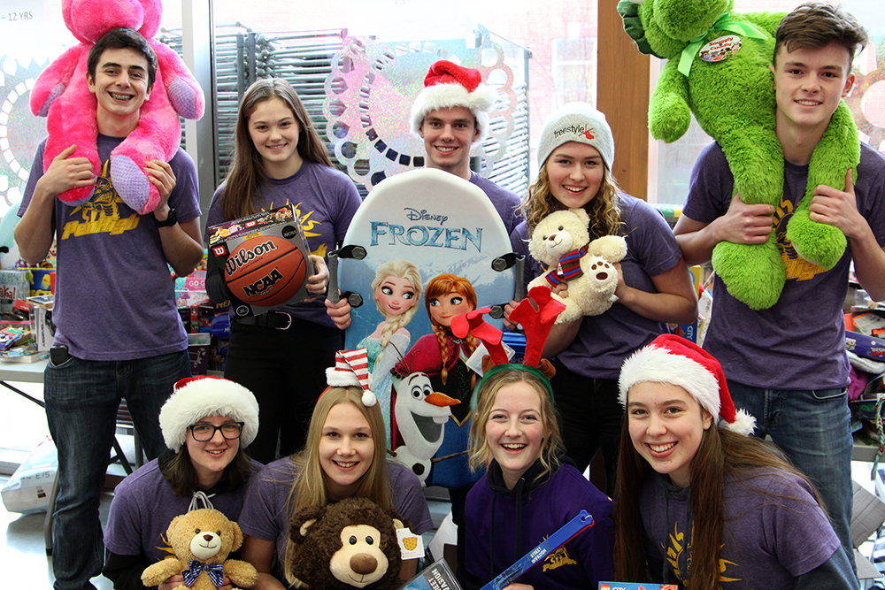 Penticton high school students surrounded by donations from the 2019 Toys for Tots and Teens drive in 2019. For 2020, organizers say new health restrictions forced them to combine 10,000 Tonight and the Toys for Tots and Teens campaigns under one umbrella: Penticton Provides.