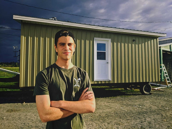 In this undated photo, Justin stands in front of his chicken coop in Saint-Georges-de-Beauce.