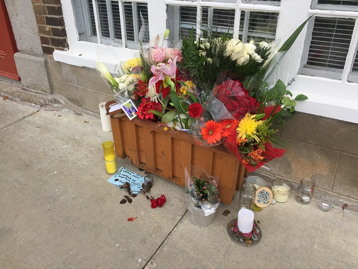 A makeshift memorial is seen on des Remparts Street, where Suzanne Claremont,61, was fatally stabbed on Saturday evening. The Quebec government is now focusing on mental health in wake of the deadly attack. Monday, Nov. 2, 2020.