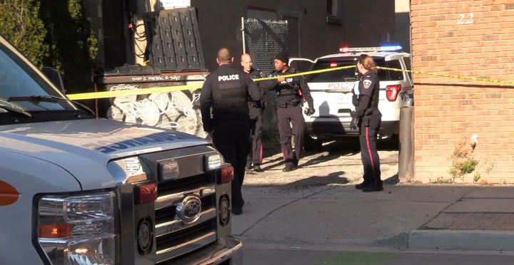 Police at the scene of a shooting in downtown Oshawa on Sunday.
