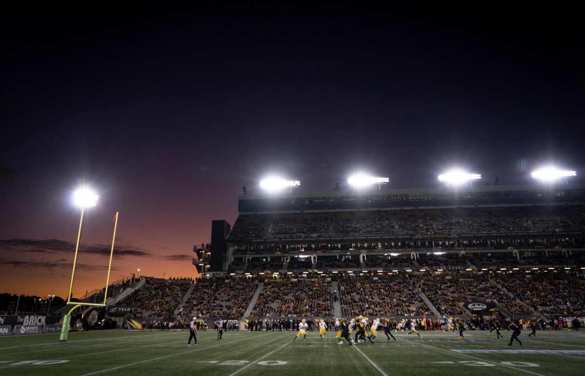 The sun sets during early first-half CFL football game action between the Hamilton Tiger Cats and the Edmonton Eskimos, in Hamilton, Ont., Friday, Oct. 4, 2019.
