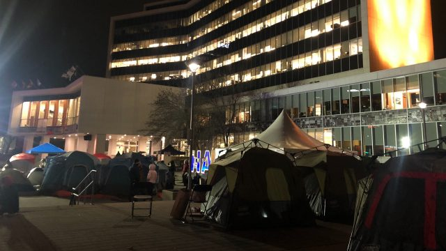 Protestors pitched tents in the forecourt at Hamilton city hall on Nov. 23, 2020 for a protest calling for a redirection of police funds to mitigate alleged  on-going housing issues in Hamilton.