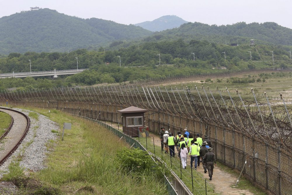 Hikers walk along the DMZ Peace Trail in the demilitarized zone in Goseong, South Korea, Friday, June 14, 2019.