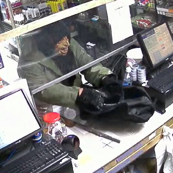 The masked suspect caught on camera during the robbery.